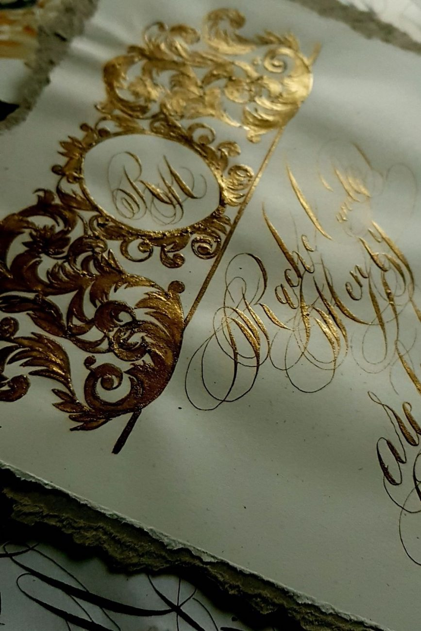 Evocative-and-emotive-artistic-invitation-cards-for-an-elegant-creme-and-gold-French-destination-wedding