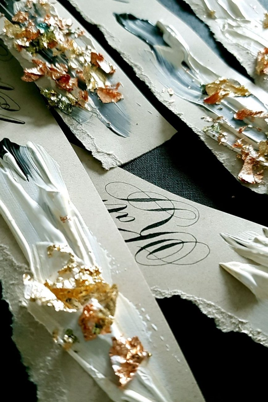 Hand torn, hand crafted gestural and abstract place name cards design with acrylic paint and gold foil leaf