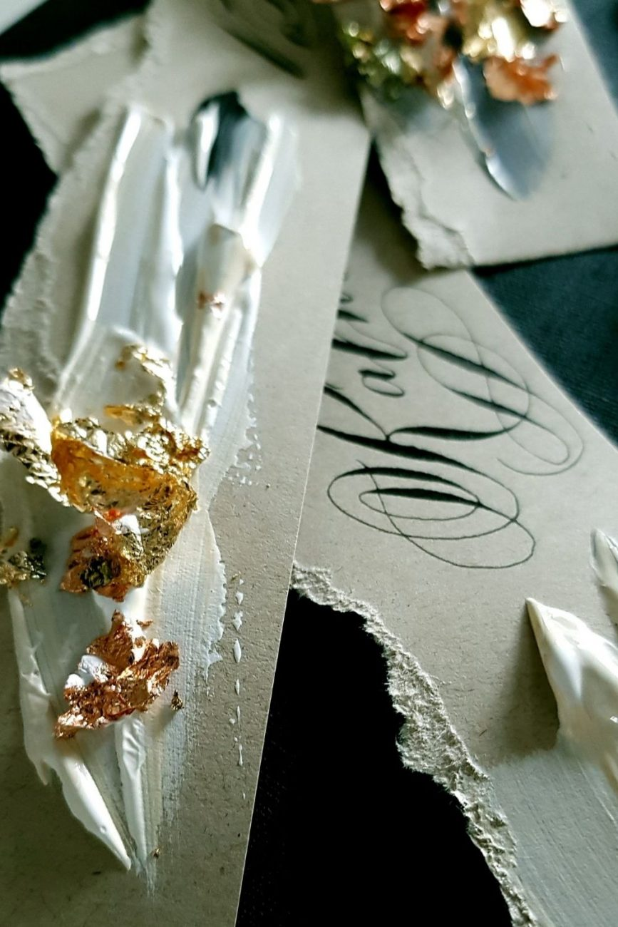 Luxury wedding stationery design with handmade, hand torn place name design